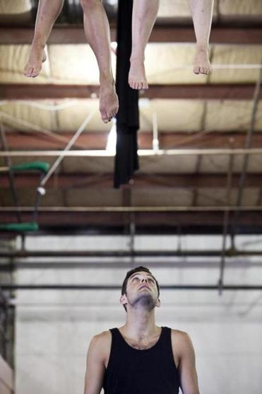 Patrick Tobin looks up at his circus partners as they practice in Somerville.