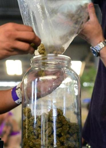 Medical marijuana is bottled for patients at a California dispensary.