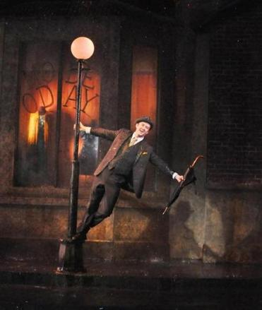 "Sean Quinn in the Reagle Music Theatre of Greater Boston production of ""Singin' in the Rain."""
