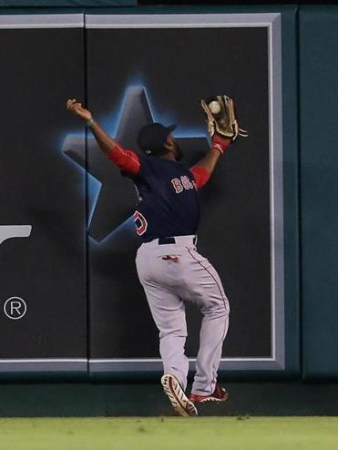 Jackie Bradley Jr. leaped to catch the ball on a deep drive by Howie Kendrick in Friday's game against the Angels.