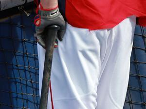 Dustin Pedroia uses a variety of substances on his bat handle, but it always winds up gooey. Jim Davis/Globe Staff.