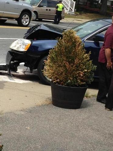 A car crashed into a Route 240 MBTA bus Tuesday, Aug. 12, injuring between 18 and 20 people.