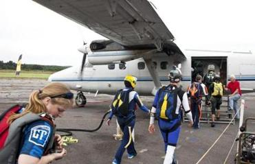 8/16/14 Orange, Mass. Skydivers loaded with gear and parachutes board the plane on Saturday evening, August 16, 2014 at Jumptown in Orange, Mass. (Zack Wittman for the Boston Globe)