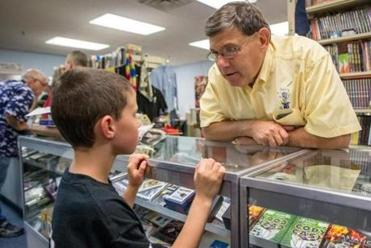 Former owner Eddie Gardner speaks with a young visitor at the newly reopened Diamond's Magic.