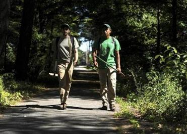 Kevin Tso (right) has been clearing and building urban hiking trails with Curtis Dunham of Michigan.