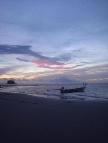 Rai Le Beach in Krabi, Thailand, is on the Andaman Sea, where a longboat was anchored at sunset.