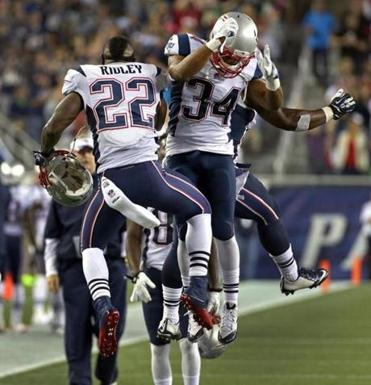 Shane Vereen (right) celebrated his second touchdown of the game with Stevan Ridley.
