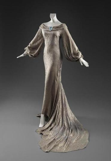 A silver lame gown designed by Travis Banton.