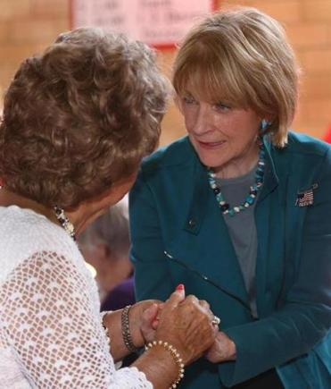 Democratic gubernatorial candidate Martha Coakley chatted with a woman at the Salem Polish Festival on Sunday.