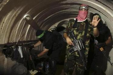 A Palestinian fighter from the armed wing of Hamas gestures inside an underground tunnel in Gaza Aug. 18.
