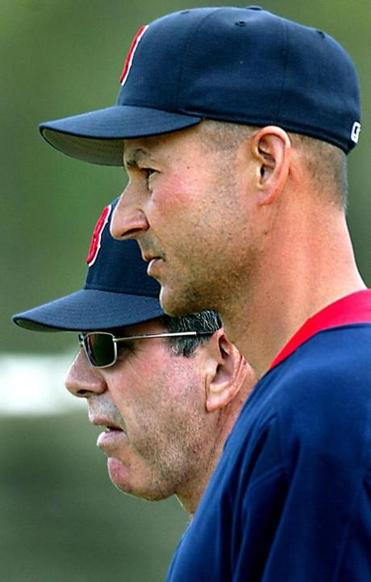 Dave Wallace (left) worked with the pitchers as Terry Francona managed the 2004 ballclub to the historic title.
