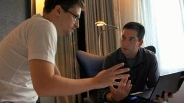 "In ""Citizenfour,"" Edward Snowden (left) spoke with reporter Glenn Greenwald in a Hong Kong hotel room."
