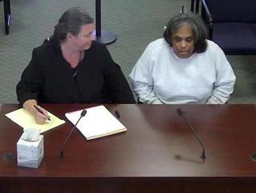 Deanne Hamilton (right) with her attorney during a Parole Board hearing in 2014.