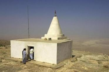 Yazidi men enter a shrine at the top of Mount Sinjar, northwest of Baghdad.