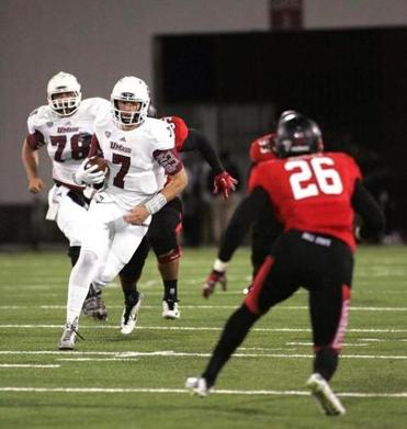 UMass quarterback Blake Fronhnapfel, on a keeper here against Ball State Nov. 12, is 50-50 to play Friday night against Buffalo. (AP Photo/The Republican, J. Anthony Roberts)