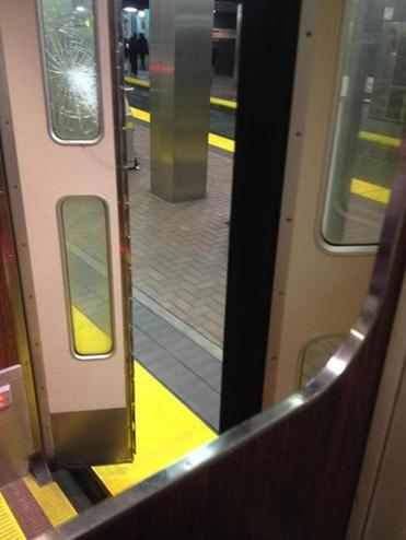 Part of a Green Line trolley door was seen at Park Street.