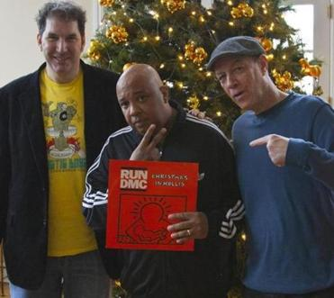 "12jingle caption for Jingle4: Director Mitchell Kezin (left) with Run-DMC's Joseph ""Rev Run"" Simmons (center) and Bill Adler, who are featured in ""Jingle Bell Rocks!,"" Kezin's new film about Christmas music collectors. Courtesy Mitchell Kezin."