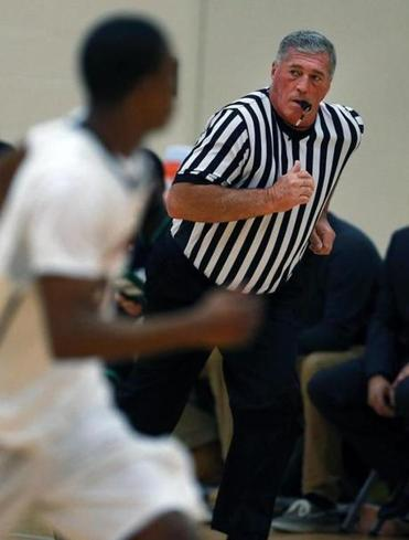12/11/14 Boston, MA: Philip Paul is pictured as he referees a basketball game between Holyoke CC and Roxbury CC at the Reggie Lewis Center. (Globe Staff Photo) section:sports topic:Paul in Roxbury NOTE: PHOTOGRAPHER REQUESTS NO CREDIT