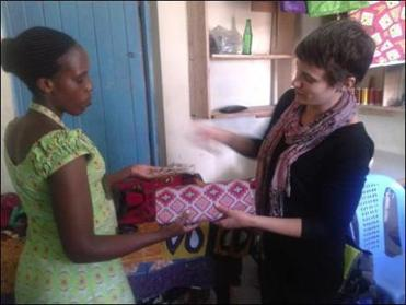 Anderson in Nairobi working with a client for RefugePoint.
