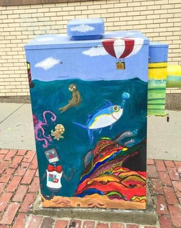 A sidewalk electric meter painted by the New Bedford Art Museum.