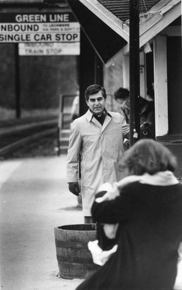 BGL/Metro print scan 3/18/1987 Brookline Ma. Longwood MBTA Station , Govenor Michael Dukakis waits for Greenline transit to wisk him to his Boston office. Globe file photo George Rizer.