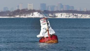 A buoy covered with ice.