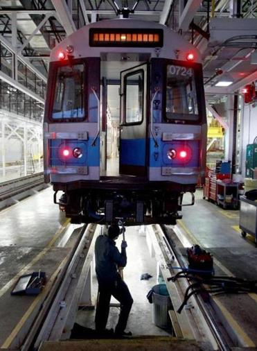 An MBTA employee worked on a Blue Line car this winter, when the transit agency experienced a service meltdown.
