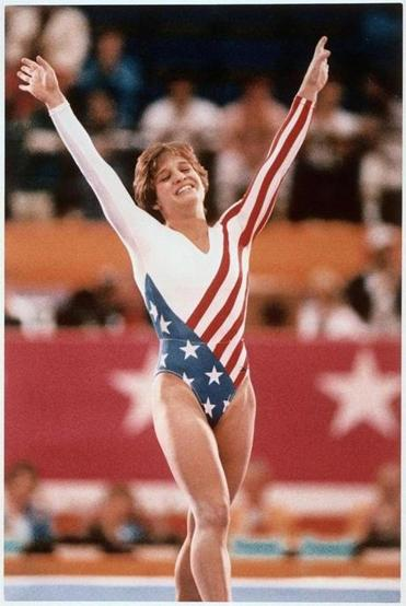 Mary Lou Retton celebrates her balance beam score at the 1984 Olympic Games in Los Angeles on Aug. 3, 1984. Retton, 16, became the first American woman ever to win an individual Olympic gold medal in gymnastics. (AP Photo)