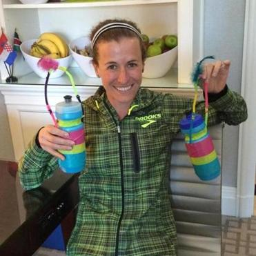 Elite Marathon runner Amy Hastings Cragg shows the handles made with pipe cleaners on the water bottles she will use in 2015 Boston Marathon. She decorated the bottles on Saturday, April 18, 2015. (Shira Springer/Globe staff)
