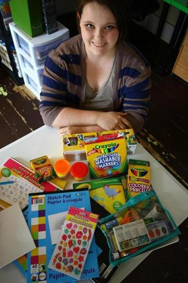 Moira Landry with art supplies she packages for kids living in homeless shelters and motels across the state.