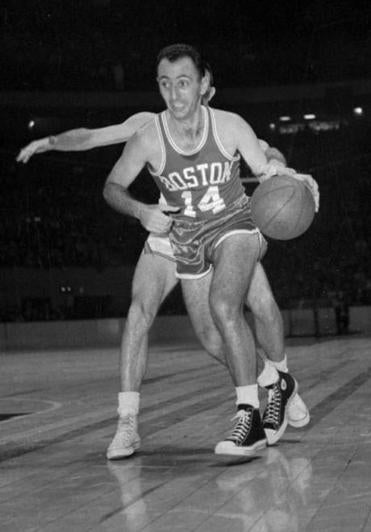 Boston Celtic Bob Cousy wears a pair of Chuck Taylors in this 1963 game against the Knicks.