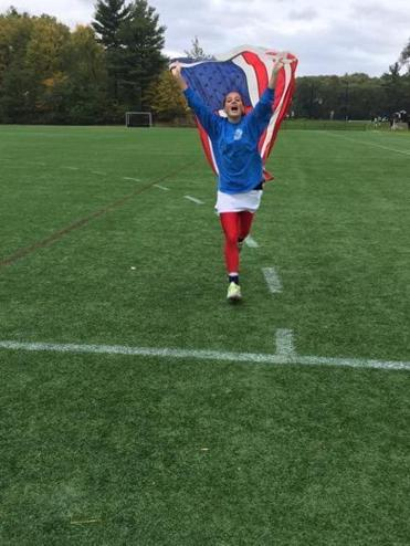 Casey Dunne waved a US flag as she ran across a field at Noble and Greenough School on Friday, shortly before her death.