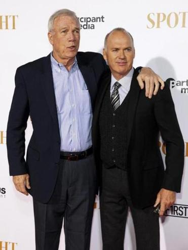 "Walter Robinson (left) and Michael Keaton, attend the premiere of ""Spotlight"" in New York."