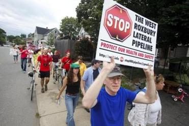 7/26/2015 - Dedham, MA - David Gallogly, cq, of Roslindale, MA, was one of the hundreds of anti-pipeline activists who rallied, marched and demonstrated in Dedham, MA on Sunday afternoon, July 26, 2015 against the West Roxbury Lateral gas pipeline. Topic: 27pipeline. Photo by Dina Rudick/Globe Staff.