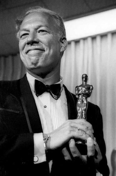 "Mr. Kennedy posed with his Oscar after winning best supporting actor for ""Cool Hand Luke."