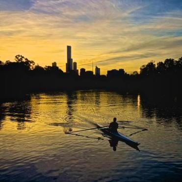 A rower on the Yarra River has the Melbourne city skyline as a stunning backdrop. Melbourne is one of Boston's sister cities.