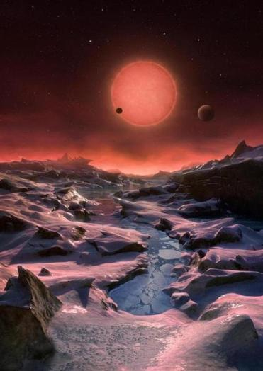 This illustration shows an imagined view from the surface of one of the three planets orbiting an ultracool dwarf star just 40 light-years from Earth.