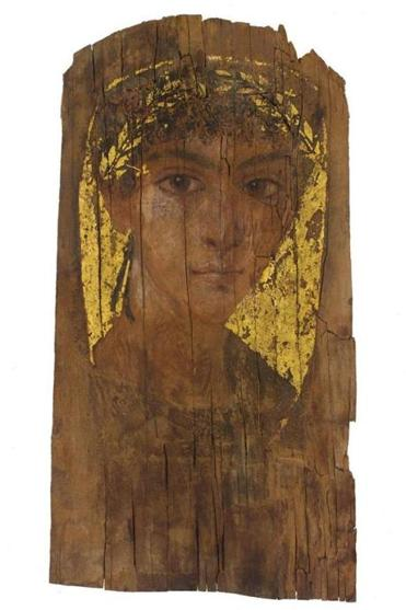 This portrait of a youth with a gilded wreath covered a mummy 2,000 years ago.