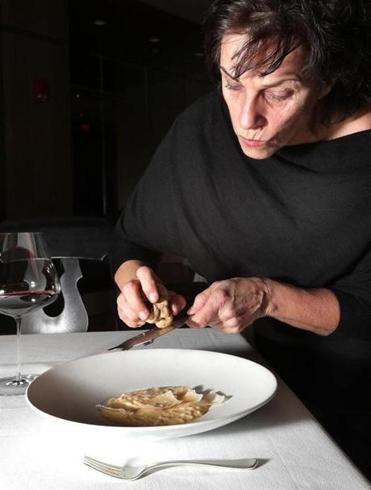 Lynch shaved white alba truffles over porcini risotto in the dining room of Menton in 2016.