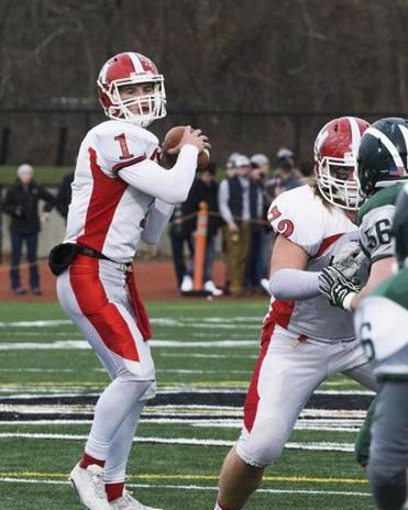 8.3.758990026_Sports_25westwood Holliston quarterback Jack Barrett (1) looks downfield for an open receiver behind the blocking of offensive lineman Scott Elliott (72) during the Thanksgiving Day football game against Westwood High in Westwood, Mass., Thursday, Nov. 24, 2016. Holliston led at the half 20-6. (Robert E. Klein for the Boston Globe)