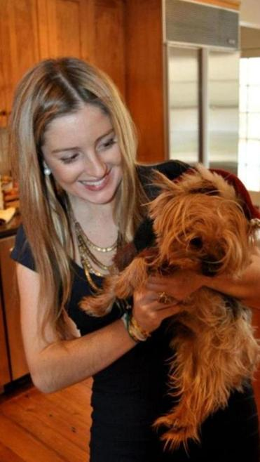 Caitlin O'Hara, pictured with her dog during Christmas 2012.