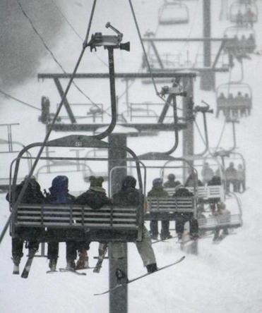 Skiers ride the lifts at Stowe Mountain Resort in Stowe, Vt.
