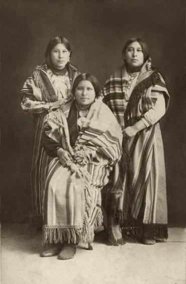 Osage tribe members (from right) Mollie, Anna, and Minnie Burkhart.