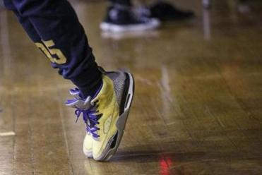 Boston, MA - 4/25/2017 - A performers stands on the tip of his shoes as he runs through a performance during rehearsal for Teen Empowerment's 25th Annual Youth Peace Conference in Boston, MA, April 25, 2017. (Keith Bedford/Globe Staff)