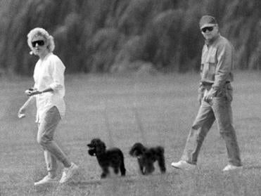 Dorchester-1988-Whitey Bulger and Catherine Greig walk together with her two poodles. BlackMassCast