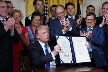 Trump signs 'historic' bill to transform VA