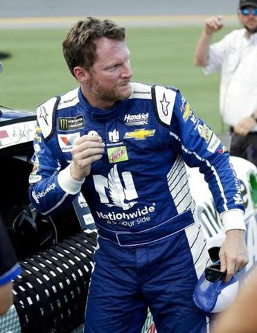 Dale Earnhardt Jr. exits his car after winning the pole position during qualifying for a NASCAR cup auto race at Daytona International Speedway, Friday, June 30, 2017, in Daytona Beach, Fla. (AP Photo/John Raoux)