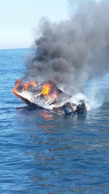 The 32-foot recreational boat Finale capsized Sunday after catching fire in the waters off Martha's Vineyard.