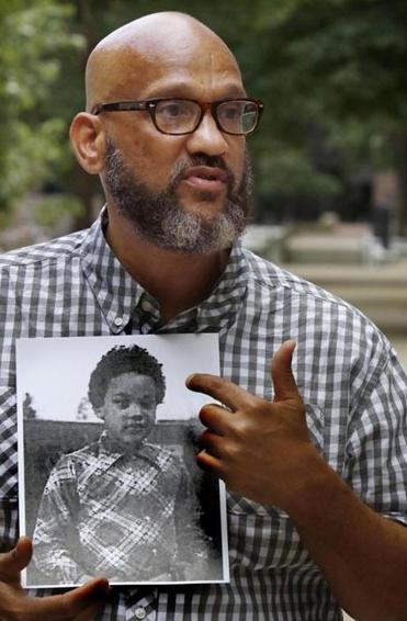 Jones held a photo of himself when he was 8 years old.