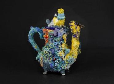 One of Al Krueger's decorated vintage teapots.